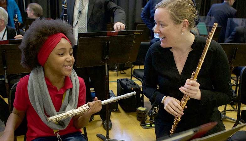 A flutist with a student