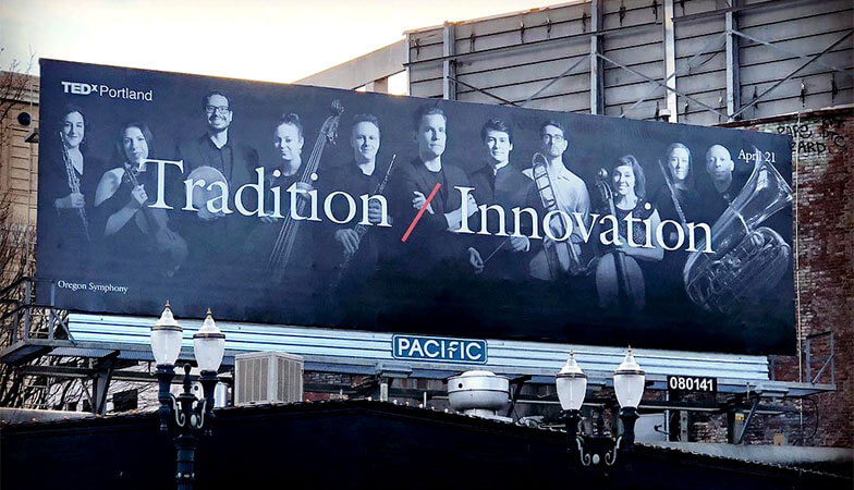 A billboard of Ted X and the Oregon Symphony