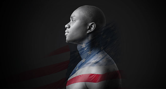 An African American man with a flag arranged over his body