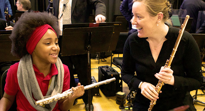 A flute teacher and a student