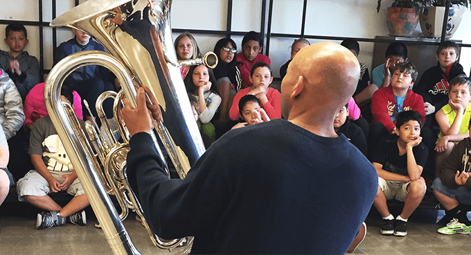 A tuba teacher and students