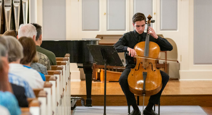 A cellist performs at a pre-concert event