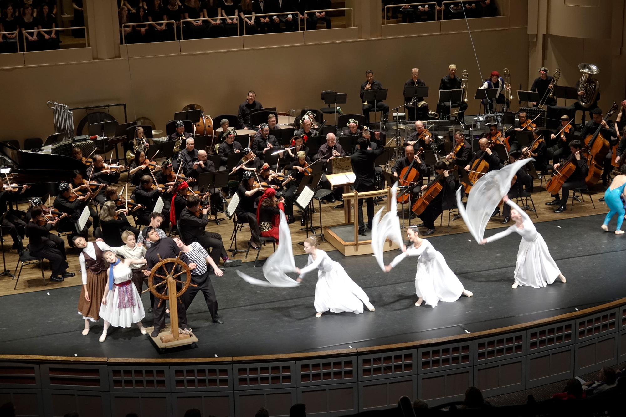 Dancers make waves in front of the orchestra