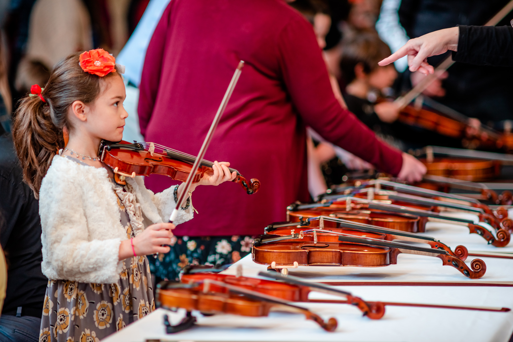 A child tries out a violin at a Kids Concert