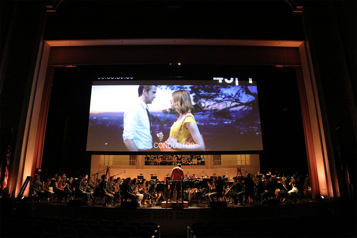 The movie screen and the orchestra