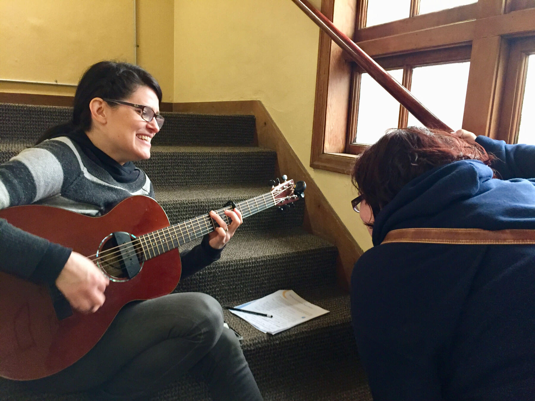 A singer-songwriter writes music with a mom